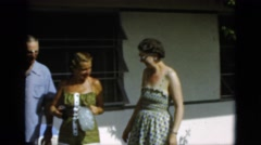 1952: group of women and men standing by a house with coke bottles CAMDEN Stock Footage