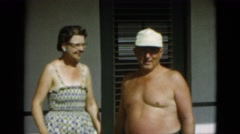 1952: topless man wearing hat posing with wife CAMDEN, NEW JERSEY Stock Footage