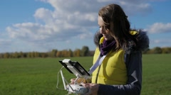The girl manages an unmanned drone Stock Footage