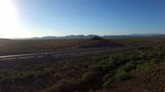 Northern Arizona highway traffic aerial Stock Footage