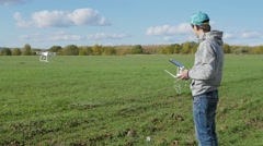 The young man manages an unmanned drone Stock Footage