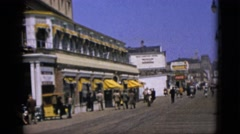 1952: tourism area men walking huge unique road yellow shade CAMDEN, NEW JERSEY Stock Footage