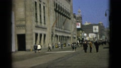 1952: people passing by a wide street with a great old building CAMDEN Stock Footage