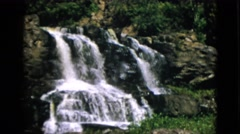 1952: beautiful waterfall flowing water down hill greenery nature CAMDEN Stock Footage