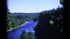 1952: a blue sky above a beautiful winding river as seen through trees CAMDEN Stock Footage