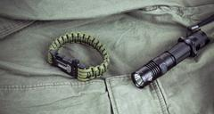 Military paracord bracelet and tactical torch Stock Photos