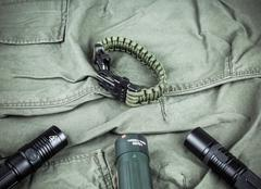Military paracord bracelet, tactical torch and spy-glass Kuvituskuvat