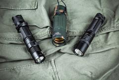 Military paracord bracelet, tactical torch and spy-glass Stock Photos