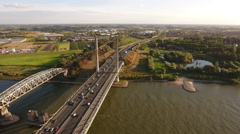 Aerial of bridge with traffic on long highway. Stock Footage
