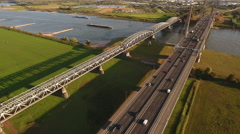 Traffic over river with transport vessels, aerial. Stock Footage