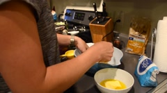 A woman adds sugar to the baking bowl full of cookie dough Stock Footage