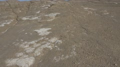 Lunar landscape dried lava of a  mud volcano.Right panoramic 4k UHD Stock Footage