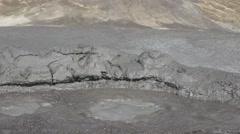 Interesting mud volcano bubble boiling sulfur strange phenomenon detail 4k UHD Stock Footage