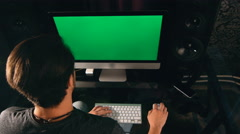 Working late. Confident young man working on his laptop PC with chroma key green Stock Footage