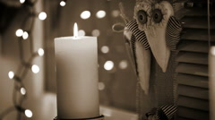 Cozy windowsill with Christmas decorations and burning candle Stock Footage