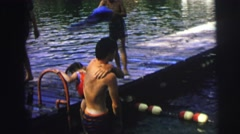 1974: kids drying off on a dock after swimming in what appears to be a lake Stock Footage