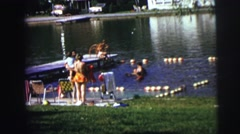 1974: children at a lake, swimming and feeding ducks CLARKSON, NEBRASKA Stock Footage