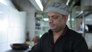 The cook working at the kitchen restaurant Stock Footage