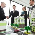 Meeting of architects and investors Stock Photos