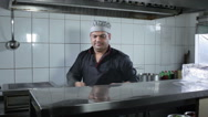 Cook preparing the dish at the kitchen restaurant Stock Footage
