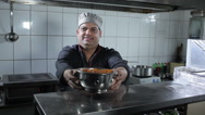 The cook presenting a dish at the kitchen Stock Footage