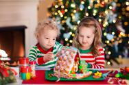 Kids making Christmas ginger bread house Stock Photos