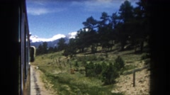 1962: landscape at the edge of the road towards a mountainous area COLORADO Stock Footage