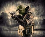 Dangerous armed terrorist with mask and gun in a thunderstorm with lightning Stock Photos