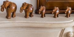 Carved wooden elephants on pedestal Stock Photos