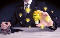 Businessman has a bright idea concept Stock Photos