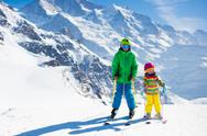 Children skiing in the mountains Stock Photos