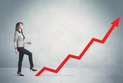 Climbing on red graph arrow Stock Photos