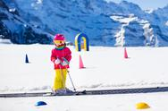 Child in ski school Stock Photos