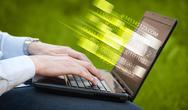 Close up of man typing on laptop computer Stock Photos