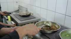 The cooks are mixing the dishes with a scoop Stock Footage