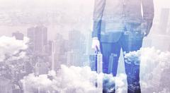 Business man standing at city view background Stock Photos