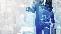 Business person standing with cityscape in the background Stock Photos