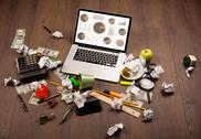 Pie chart graph icons on laptop screen with office accessories Stock Photos