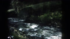1962: a beautiful river cutting through a mountain as seen from a moving vehicle Stock Footage