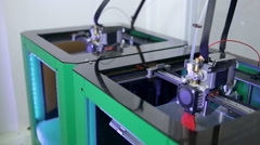 Two 3D printers creating objects Stock Footage