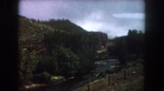 1962: view from a moving train of a winding valley and river  Stock Footage