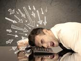 Arrows pointing at sad office worker Stock Photos