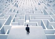 Businessman staring at infinite maze Stock Photos