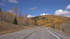 Drive autumn fall tree colorful mountain highway POV 4K Stock Footage