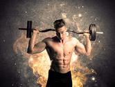 Healthy hot male showing muscles with fire Stock Photos