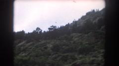 1962: grassland vast area sunlight and mountains tree pointed OMAHA, NEBRASKA Stock Footage