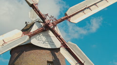 Old windmill against the sky Stock Footage