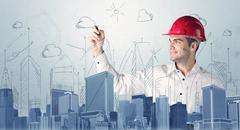 Young worker drawing a city sight Stock Photos
