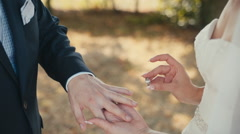 The groom the bride wears the ring Stock Footage