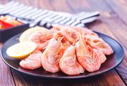 Shrimps on plate on a table Stock Photos